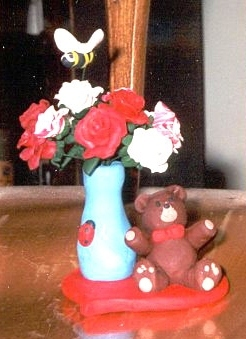 bear with a dozen roses