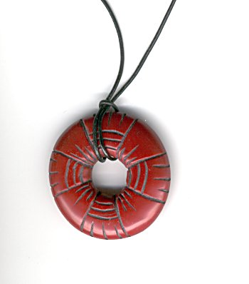 carved donut pendant